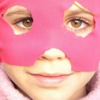 Girl with pink mask